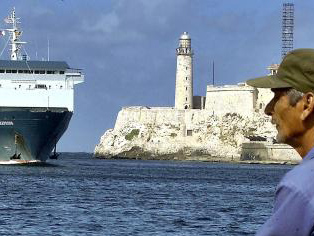 A Havana resident watches as the Express
