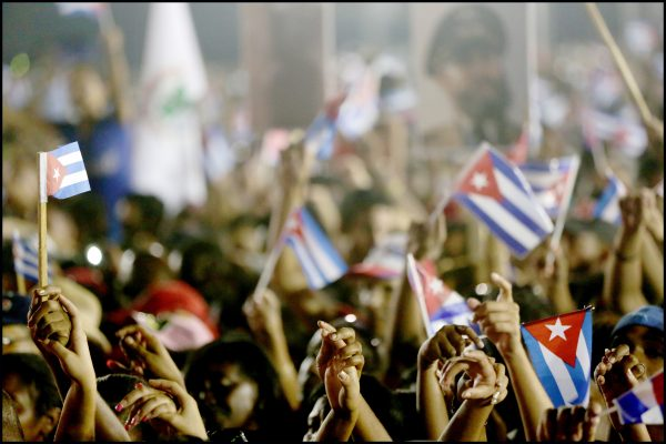 Attendees hold hands and sing during the final public tribute to Fidel Castro in Santiago de Cuba on Saturday, Dec. 3, 2016. Castro's funeral will be held Sunday.