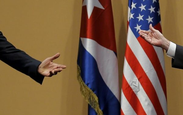The hands of Barack Obama and Raul Castro during a news conference as part of Obama's three-day visit to Cuba, in Havana March 21, 2016. Carlos Barria : Reuters file photo