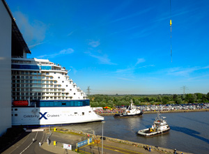 Celebrity-Reflection-emerging-from-yard-with-tugs---August-12,-2012