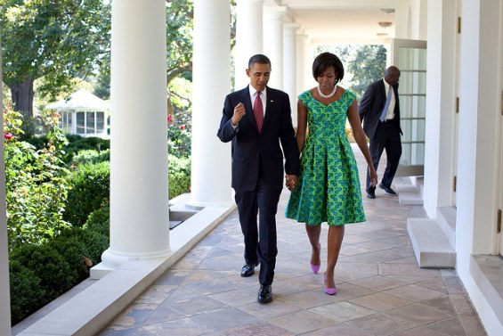 michelle obama and barack obama walk hand in hand outside the white house