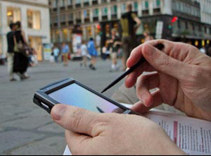 business-man-making-notes-on-smartphone
