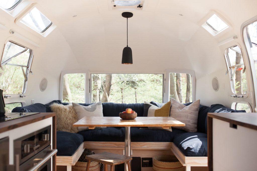modern-caravan-vintage-airstream-renovation-dining-1466x978