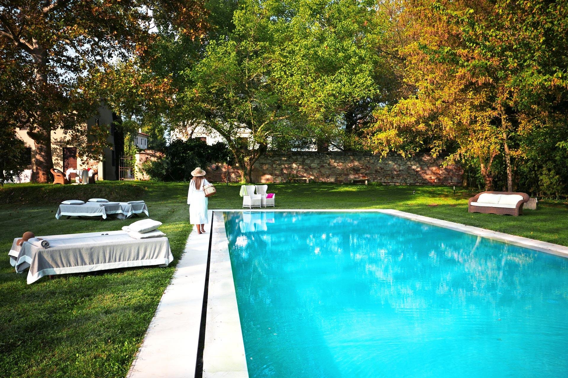 The swimming pool in the park of Barchessa di Villa Pisani, a XVI century mansion, close to Vicenza