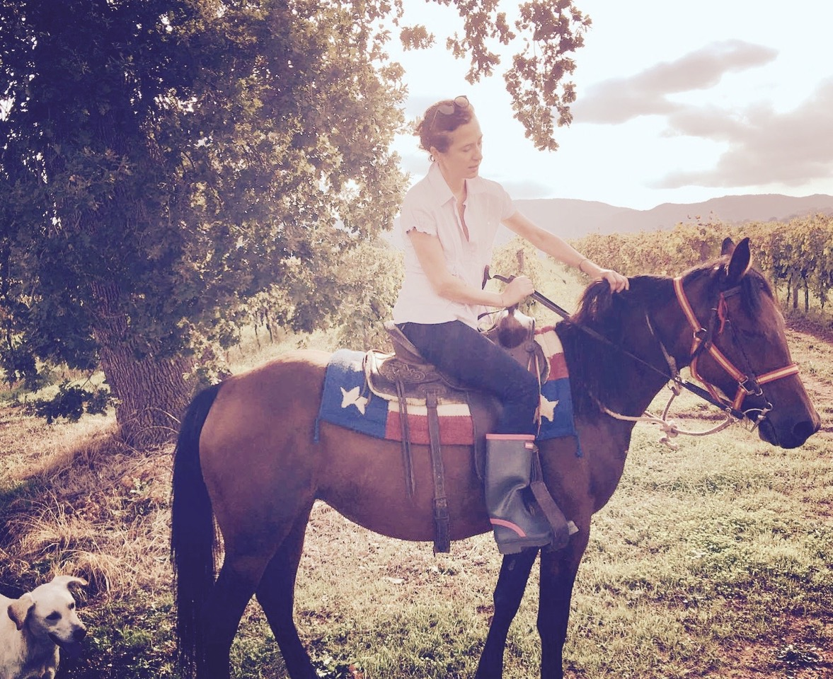 Laura Pacelli riding a horse in her domaine in Calabria